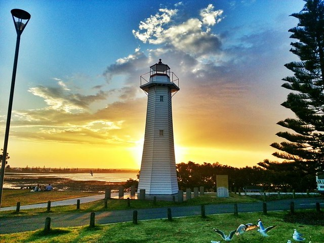 Cleveland point light house, at sunset on a smokey afternoon.