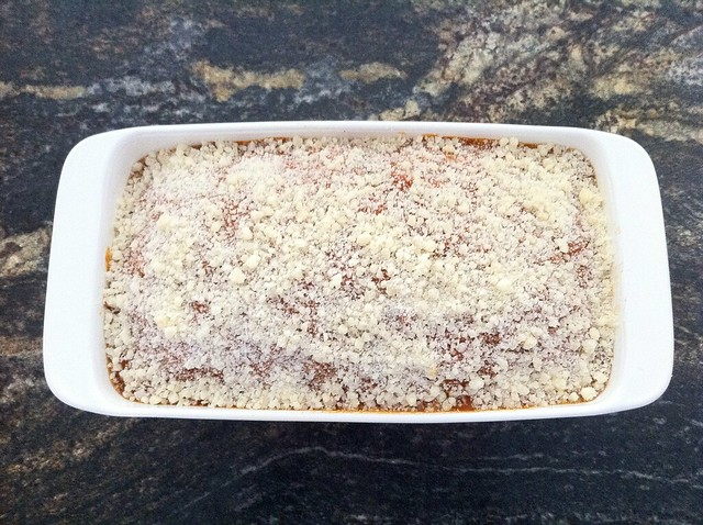 Meatloaf Topped with Marinara and Grated Parmesan Cheese