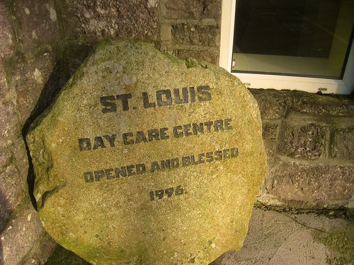 Stone inscribed plaque celebrating the opening of the St Louis Day Care Centre in 1996
