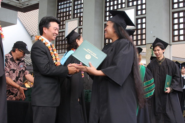 "<p>Governor Shan Tsutsui shakes a graduate's hand at Maui College's commencement ceremony on Maui Arts and Cultural Center A&B Amphitheater on May 18, 2014.<br /> <br /> For more photos go to <a href=""https://www.facebook.com/media/set/?set=a.708765329188361.1073741867.225796587485240"" rel=""nofollow"">www.facebook.com/media/set/?set=a.708765329188361.1073741...</a></p>"