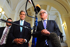 U.S. Secretary of State John Kerry listens to German Foreign Minister Frank-Walter Steinmeier address reporters in Vienna, Austria, on July 13, 2014, amid a series of P5+1 talks with Iran about its nuclear program. [State Department photo/ Public Domain]