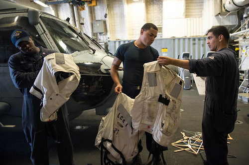 Sailors aboard the littoral combat ship USS Freedom (LCS 1) conduct an inventory of deck equipment