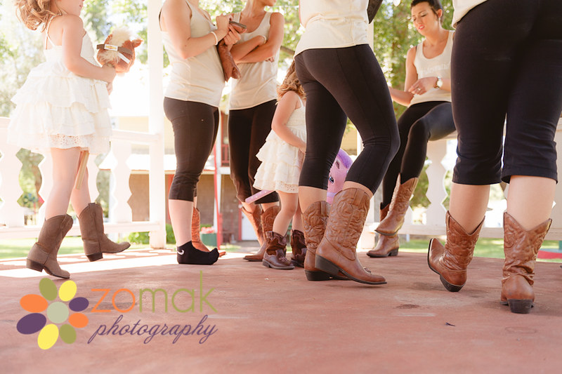 Fun perspective of the bridal party in their cowgirl boots.