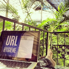 Final tweaks to my #bdconf slides. On my balcony. In some kind of tropical forrest. In a biodome. Full of tasty burger. Tough life.