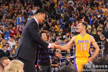 October 15, 2013 - Yao Ming and Steve Nash greet each other at a preseason game in Beijing
