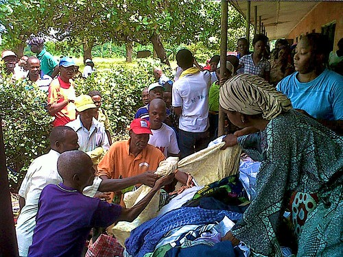 Sisters providing relief supplies to victims of flooding in Ewulu