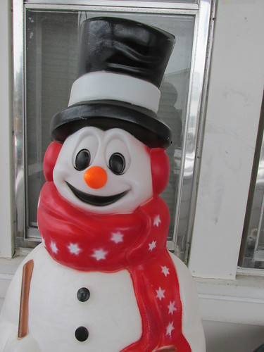 A seasonal outdoor light up plastic snowman on the front porch.  Elmwood Park Illinois.  December 2013. by Eddie from Chicago