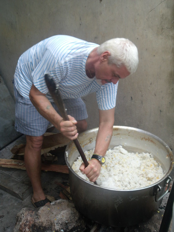 Papa Kevin helps prepare the food