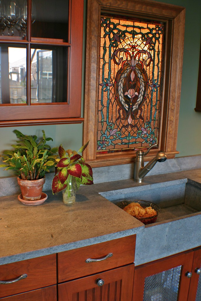 handmade soapstone sink and stained glass window