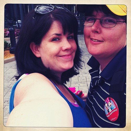 My love and I in disney two years ago.  We'll be back soon.  Also, this pic *almost* makes me want to cut my hair.  #tbt