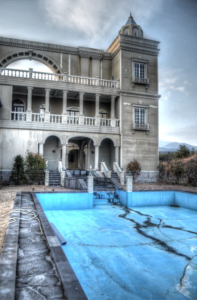 Empty Swimming Pool at Abandoned Movie Set Hotel