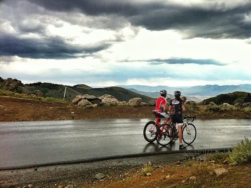 Cyclists atop a rainy Empire Pass