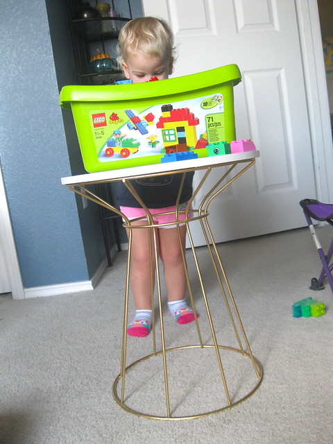 J playing with side table