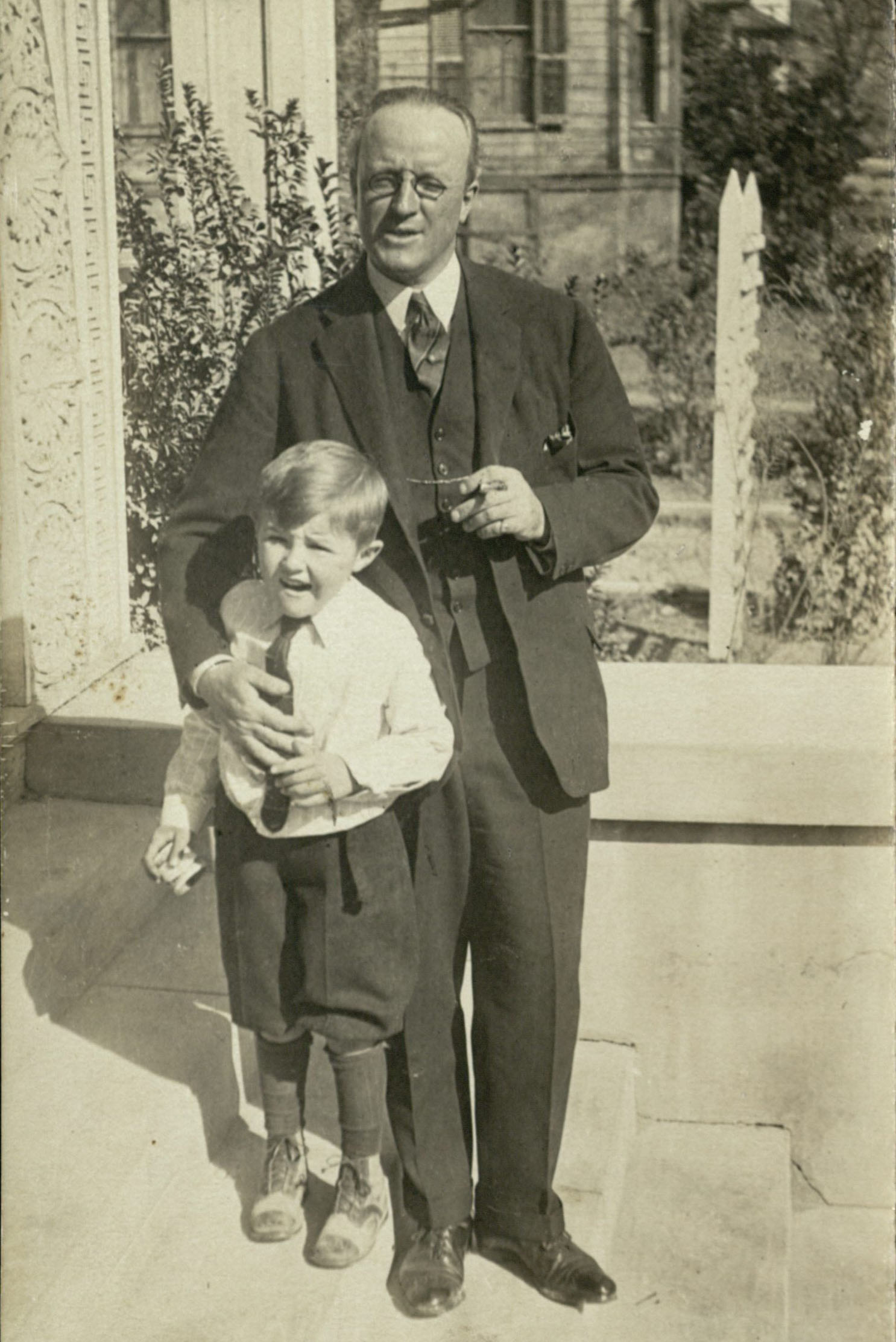 Carl Lovelace with one of his sons outside their home in Waco, undated