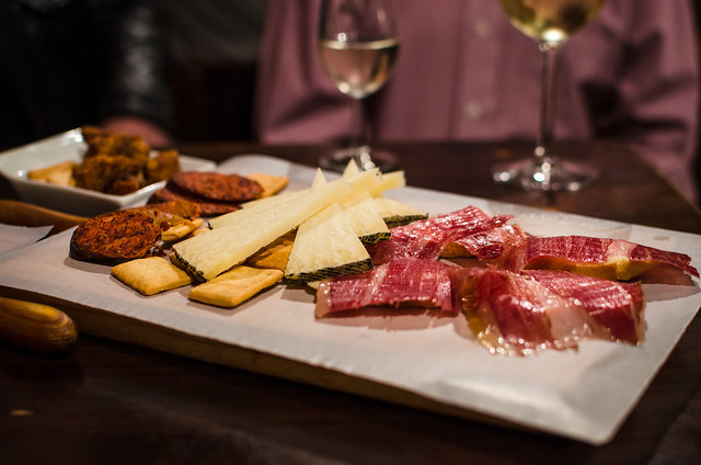 A plate of Jamón ibérico de bellota, manchego cheese, and venison chorizo at Casa Morales in Sevilla.