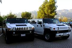 military vehicle(0.0), hummer h1(0.0), sedan(0.0), automobile(1.0), automotive exterior(1.0), sport utility vehicle(1.0), vehicle(1.0), hummer h3(1.0), hummer h2(1.0), hummer h3t(1.0), bumper(1.0), land vehicle(1.0), luxury vehicle(1.0), limousine(1.0), motor vehicle(1.0),