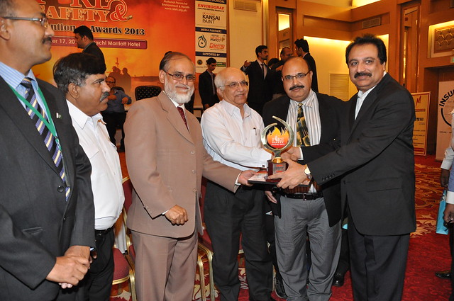 Minister for Environment Dr. Sikander Mandhro giving away fire safety award to Engro Head of Administration Wajid Hussain Junejo in a ceremony organized by Fire Protection Association of Pakistan FPAP and NFEH