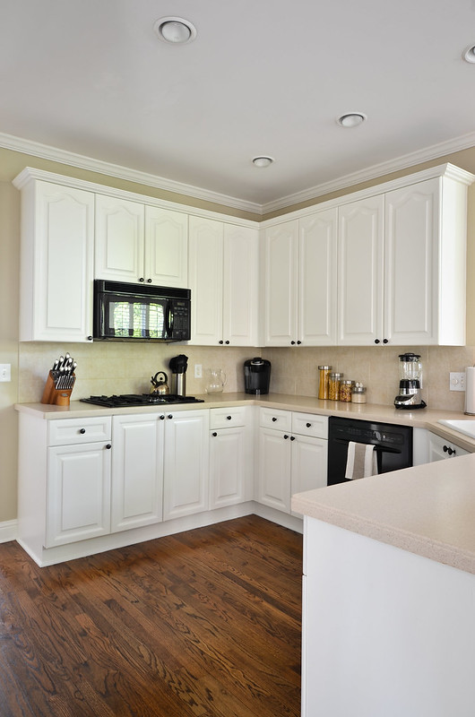 Painted kitchen cabinets before and after to newlywedism for Kitchen colors with white cabinets with john lennon wall art