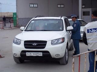 Customs officer checking papers of a Libyan car at the Ras Jdir border crossing. Image credit: Abdel Aziz Hali