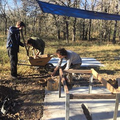 Ari from Doors unlimited pours a post for their piece with the Habitable Spaces Crew.  #doorsunlimited #artistresidency #sustainableliving #habitablespaces #naturalbuilding