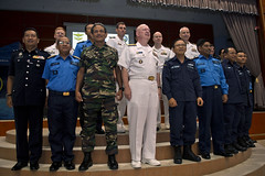 Representatives from U.S. and Malaysia stand together during the closing ceremony for exercise Cooperation Afloat Readiness and Training (CARAT) Malaysia 2013. (U.S. Navy photo by Mass Communication Specialist 3rd Class Amanda S. Kitchner)