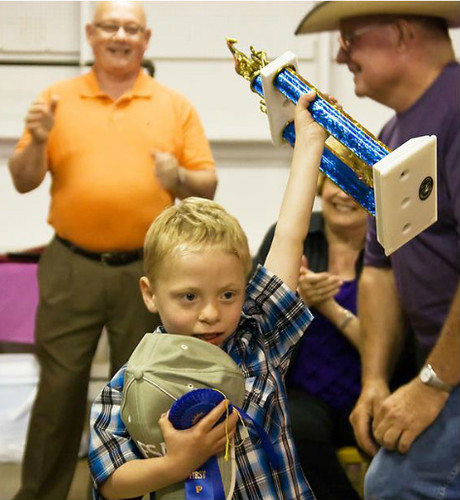 "Five-year-old Joe Joe Charles celebrates being named ""Cowboy Of The Year."" Photo by Bob Haentzler"