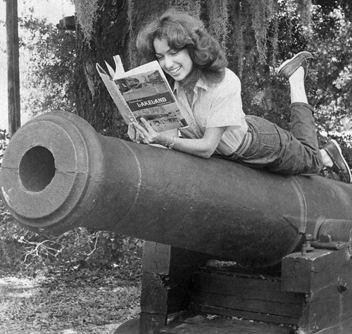 Woman Reading on Top of Library Cannon by Lake Wales Public Library Archives