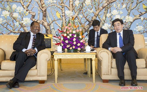 Guo Jinlong (R), a member of the Political Bureau of the CPC Central Committee, meets with a ZANU-PF delegation headed by Rugare Gumbo, ZANU-PF, in Beijing, Nov. 29, 2013. (Xinhua/Huang Jingwen) by Pan-African News Wire File Photos