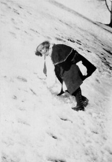 Miss Vera Bury climbing the side of a mountain in winter / Mademoiselle Vera Bury escalade une montagne en hiver