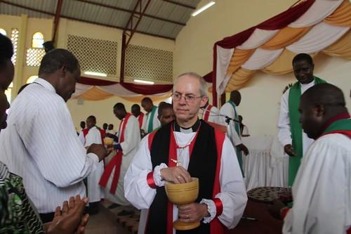 Archbishop Justin serves the host at Eucharist