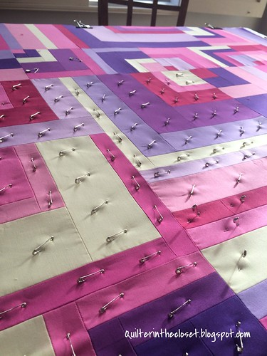 basting another pink baby quilt