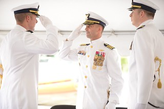 During a change of command ceremony Friday, July 11, 2014, in St. Marys, Georgia, Cmdr. Matthew Baer relinquished command of Coast Guard Maritime Safety and Security Team Kings Bay to Lt. Cmdr. Eric Casper. (U.S. Coast Guard photo by Petty Officer 1st Class Lauren Jorgensen)