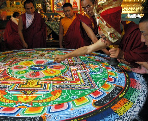 HH Dagchen Sakya draws a line through the Hevajra sand mandala after initiation, holding a gold dorje & ringing a vajra handled bell, three masters of ceremony assist, one monk observes, Sakya Lamdre, Tharlam Monastery Shrineroom, Boudha, Kathmandu, Nepal by Wonderlane