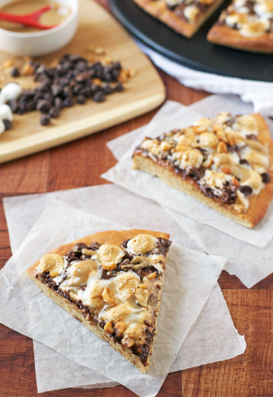 Peanut Butter S'mores Pizza: Gooey chocolate dessert pizza with marshmallows and peanut butter sauce.