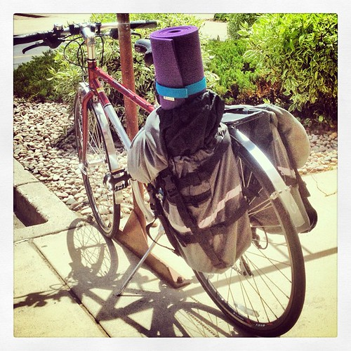 My loaded down bike just before racing a thunderstorm home after working, BodyPump, and yoga. There's an old (heavy) laptop, power adapter, external hard drive, water bottle, thermos, and that is a #Manduka Pro yoga mat (heavy, closed cell, thick). #hardc