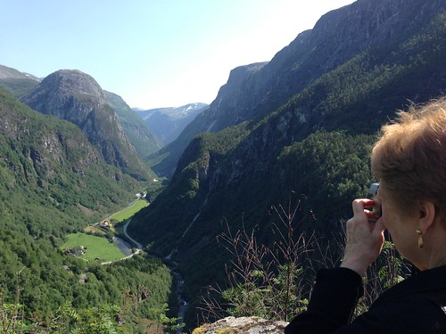 Joan takes a picture of a mountain gorge near Stalheim Norway