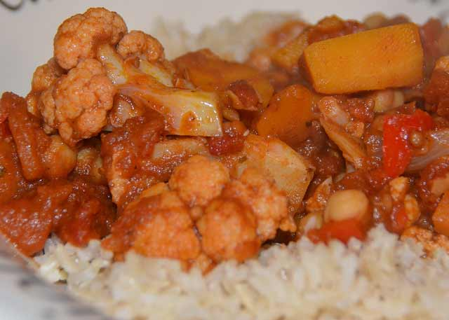 Chickpeas and vegetables in a spicy sauce on a bed of rice
