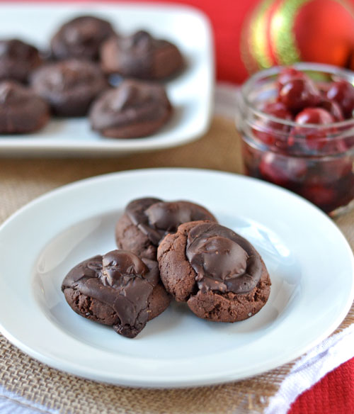 Black Forest Cookies: Chocolate thumbprint cookies with a cherry center and fudge frosting.