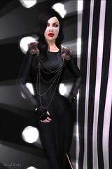 leather(0.0), little black dress(0.0), neck(1.0), textile(1.0), model(1.0), latex clothing(1.0), clothing(1.0), sleeve(1.0), fashion(1.0), formal wear(1.0), photo shoot(1.0), haute couture(1.0), dress(1.0), black(1.0),