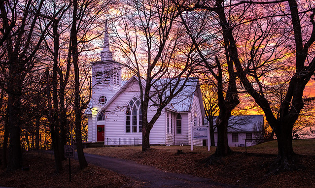 Fiery Sunset Over Country Church
