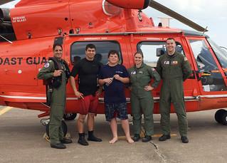 A Coast Guard Air Station Houston MH-65 Dolphin helicopter crew diverted to rescue a 12-year-old boy that had drifted 300-400 yards into the ocean on an innertube off Crystal Beach, on Bolivar Peninsula in Texas, June 10, 2014. The boy was reportedly swimming with his family when he was pulled out and could not get back in. U.S. Coast Guard photo.
