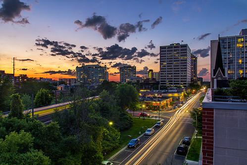 roof sunset sky car skyline clouds train buildings landscape illinois downtown day cityscape traffic cloudy evanston partlycloudy lighttrail chicagoist nevinspub