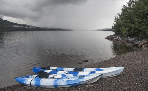 Watersports - Canoes by Scottish Loch