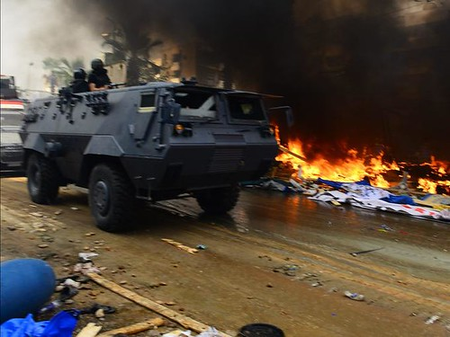 Egyptian military forces storm encampments protesting the coup killing hundreds and setting fire to tents. The latest massacre took place on August 14, 2013. by Pan-African News Wire File Photos
