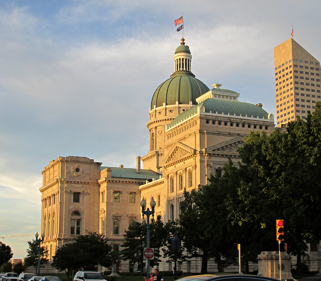 The Indiana Statehouse with the light of the sunset shining on it