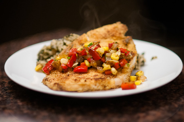 cajun cornmeal-crusted haddock with warm corn relish and brown rice florentine