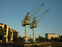 A pair of rusty cranes in the sunset at Salford Quays...
