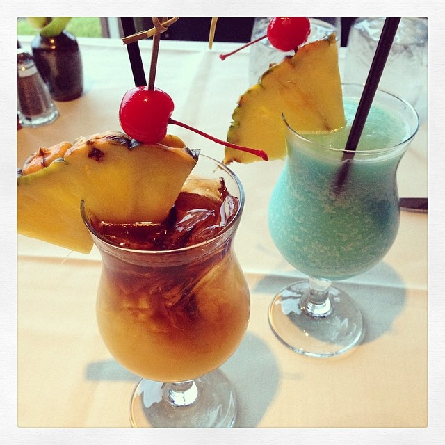 Celebratory Hawaii drinks! Mai tai and Blue Hawaiian.