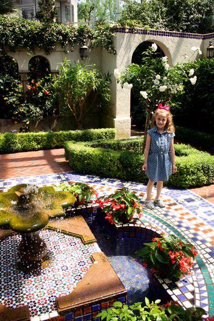 Aut-standing-in-garden