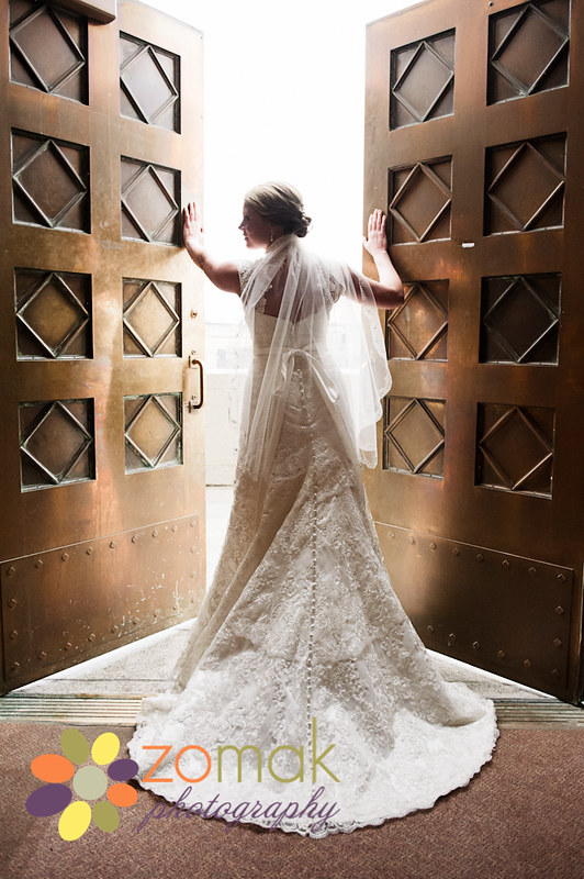 zo-mak photography captures beautiful portrait of bride in the church doorway.